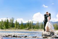 Bride and groom kissing in the rocky mountains